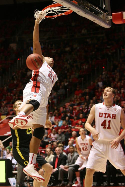 Leah Hogsten     The Salt Lake Tribune Utah Utes forward Jordan Loveridge (21) dunks. University of Utah defeated Oregon 72-62  Saturday, March 9, 2013 at the Jon M. Huntsman Center.