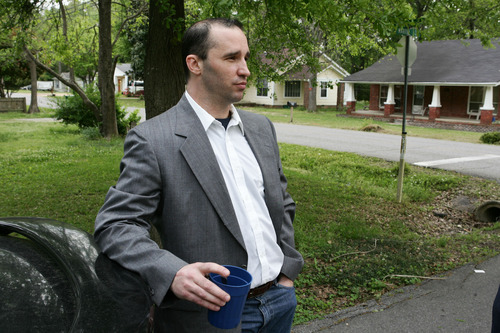 Everett Dutschke stands in the steet near his home in Tupelo, Miss., and waits for the FBI to arrive and search his home Tuesday April 23, 2013 in connection with the sending of poisoned letters to President Barack Obama and others last week. Paul Kevin Curtis, the man charged with sending the letters, was released from jail Tuesday on bond, while FBI agents returned Dutschke's house where they'd previously searched in connection with the case. (AP Photo/Northeast Mississippi Daily Journal, Thomas Wells) MANDATORY CREDIT