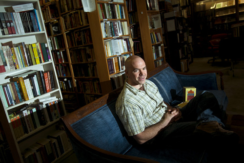 Chris Detrick  |  The Salt Lake Tribune Tim DeChristopher works at Ken Sanders Rare Books Tuesday April 23, 2013. DeChristopher was released just Sunday from his 21-month term for fraudulently bidding on public land leases at a 2008 Bureau of Land Management oil and gas auction. He had hoped to prevent drilling on sensitive land.
