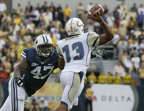 Rick Egan  | The Salt Lake Tribune   Brigham Young Cougars linebacker Ezekiel Ansah (47) puts the pressure on Georgia Tech Yellow Jackets quarterback Tevin Washington (13) in football action BYU vs Georgia Tech, at Bobby Dodd Stadium in Atlanta, Saturday, October 27, 2012