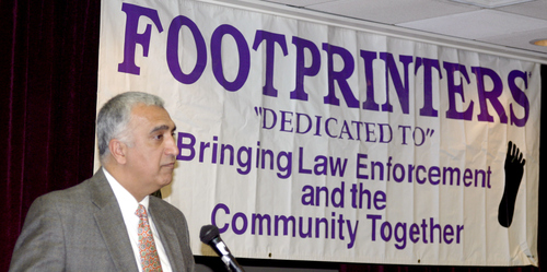 "Courtesy of Salt Lake County District Attorney's Office  Salt Lake County District Attorney Sim Gill accepts an award Tuesday for law enforcement Officer of the Year from the local chapter of the International Footprint Association. He called the award ""an honor."""