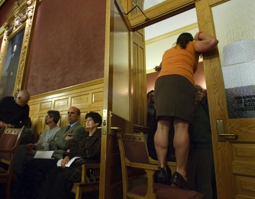 Leah Hogsten     The Salt Lake Tribune Salt Lake City Council staff member Lehua Weaver took to a chair to get her point across to the attendees hoping to get a seat in the chamber. Sugar House residents packed City Hall by the hundreds to give their opinions to the Salt Lake City Council regarding a future extension of the Sugar House Streetcar, April 23, 2013.