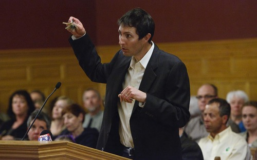Leah Hogsten     The Salt Lake Tribune Ben Leatham jingles his keys to remind the crowd of how much Americans love their cars in support of the rail line proposals. Sugar House residents packed City Hall by the hundreds to give their opinions to the Salt Lake City Council regarding a future extension of the Sugar House Streetcar, April 23, 2013.