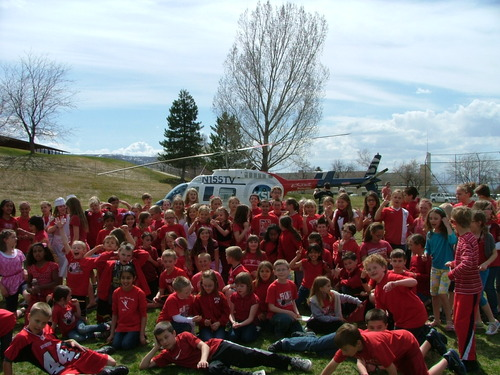 Students from Valley View Elementary in Bountiful, Utah, pose in front of KSL's Chopper 5, which visited the school to celebrate the school's reading achievement. Courtesy of Ted Hallisey