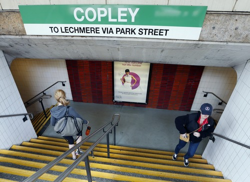 People use the entrance to the Copley Square transit station in Boston, Wednesday, April 24, 2013. The station opened on Wednesday morning for the first time since two explosions at the Boston Marathon on April 15. (AP Photo/Michael Dwyer)