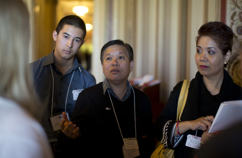 From left, Shirley Tan, Jay Mercado, center, Shirley Tan and one of their twin sons Jorien Mercado,16,  wait on Capitol Hill in Washington, Wednesday, April 24, 2013, for their meetingwith Senate Majority Leader Harry Reid of Nev. Shirley is undocumented and Jay is an American citizen. They have been together for 27 years and have raised Jorien and his brother Jashley. They and other gay rights activists are lobbying Senators today pushing to change the immigration bill to allow gay Americans to sponsor visas for their same-sex partners the way straight Americans can. Democrats are treading carefully on a proposed addition to the bipartisan immigration overhaul.  (AP Photo/Carolyn Kaster)