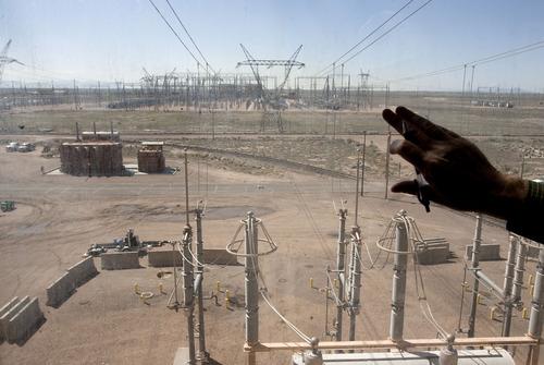 Steve Griffin | The Salt Lake Tribune  Power leaves the Intermountain Power Plant near Delta, Utah through an array of power lines Friday April 12, 2013.