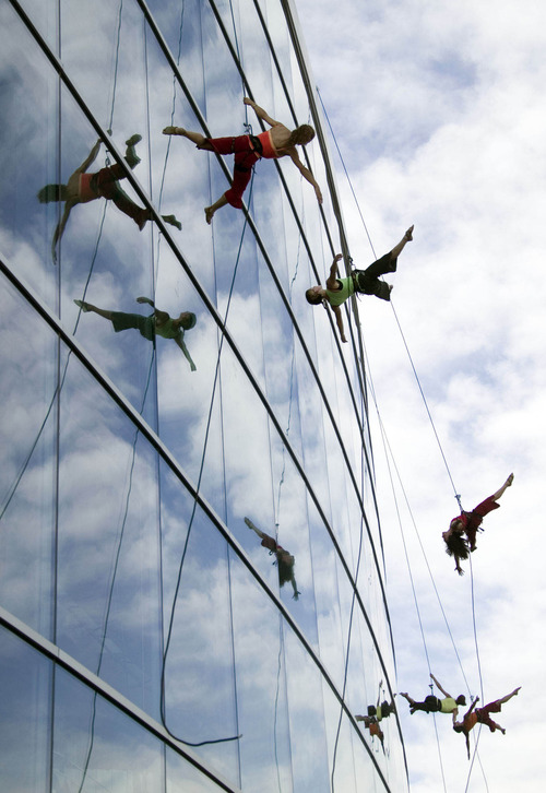 The vertical dance troupe Bandaloop, performing on the side of the Salt Lake City Library's main branch at the 2005 Utah Arts Festival. The troupe will return to the 2013 Utah Arts Festival, organizers announced Thursday, April 25. (Danny Chan La     Tribune file photo)