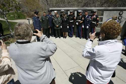 Rick Egan  | The Salt Lake Tribune   Friends and family members take photos of Korean War veterans at the Korean War Memorial at Memory Grove, Wednesday, April 24, 2013. The ceremony was part of a larger effort to remember veterans of the Korean War, which began June 25, 1950, and ended in July 1953.