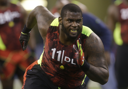 FILE - In this Feb. 25, 2013 file photo, Florida defensive lineman Sharrif Floyd runs a drill during the NFL football scouting combine in Indianapolis. Floyd is a possible first round pick in the NFL Draft on Thursday, April 25, 2013. (AP Photo/Dave Martin, File)