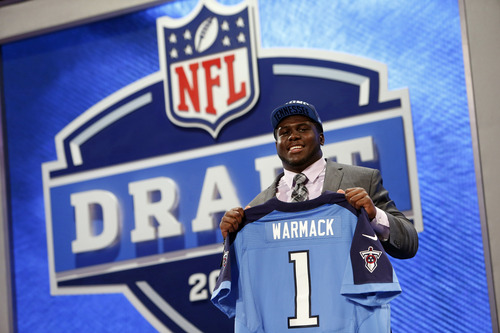Guard Chance Warmack from Alabama holds up the team jersey after being selected 10th overall by the Tennessee Titans in the first round of the NFL football draft, Thursday, April 25, 2013 at Radio City Music Hall in New York.  (AP Photo/Jason DeCrow)