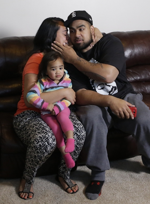 Star Lotulelei receives a kiss from his wife Fuiva, who holds their daughter Pesatina, 1, after being selected 14th overall by the Carolina Panthers during an NFL football draft party at their home, Thursday, April 25, 2013, in South Jordan, Utah.  (AP Photo/Rick Bowmer)