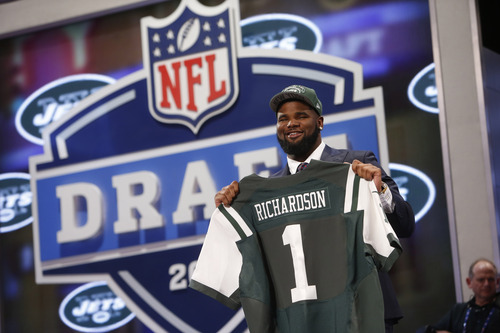 Sheldon Richardson, from Missouri, holds up a team jersey after being selected 13th overall by the New York Jets in the first round of the NFL Draft, Thursday, April 25, 2013, at Radio City Music Hall in New York. (AP Photo/Jason DeCrow)