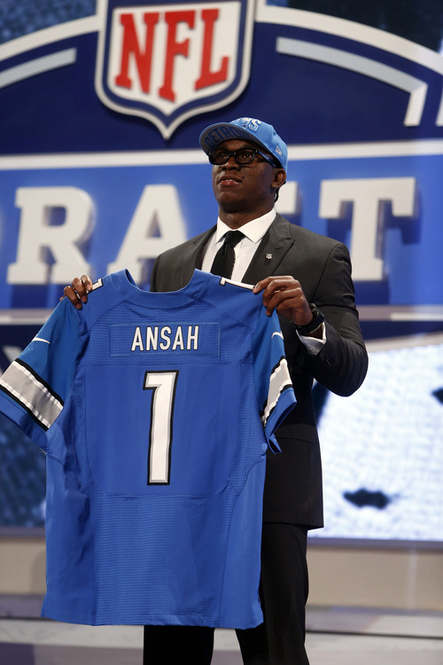 Ezekiel Ansah, from Brigham Young, holds up a team jersey after being selected fifth overall by the Detroit Lions in the first round of the NFL football draft, Thursday, April 25, 2013, at Radio City Music Hall in New York. (AP Photo/Jason DeCrow)