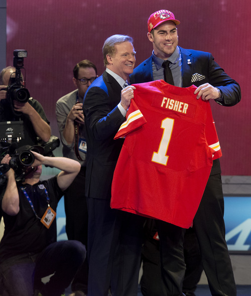 Central Michigan's Eric Fisher stands with NFL Commissioner Roger Goodell after being selected first overall by the Kansas City Chiefs in the first round of the NFL football draft, Thursday, April 25, 2013, at Radio City Music Hall in New York. (AP Photo/Craig Ruttle)