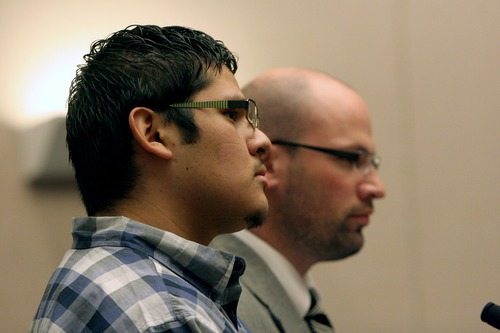 Jesse Anthony Saenz, foreground, stands with his attorney, Clint Hendricks, during a status hearing Tuesday, March 26, 2013, in 8th District Court. Saenz, 23, is accused of attacking a Uintah County woman and sexually assaulting her in June 2012. (AP PHOTO/Geoff Liesik, Deseret News)