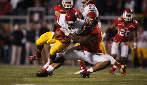 Scott Sommerdorf  |  The Salt Lake Tribune              Utah Utes defensive tackle Star Lotulelei (92) pulls down USC Trojans running back Silas Redd (25) for a loss during first half play. USC led Utah 24-21 at the half, Thursday, October 4, 2012.