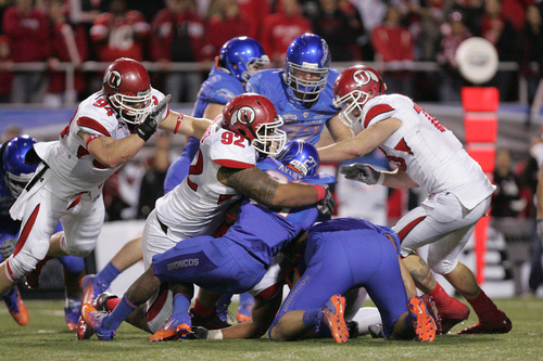 2010 DEC 22: Utah's Christian Cox (94), Star Lotulelei (92), and Chad Manis (18) tackle Boise State's Jeremy Avery (27) during the 2010 Maaco Las Vegas Bowl NCAA Football game between Boise State and Utah at Sam Boyd Stadium in Las Vegas, NV. Boise State won 26-3 (Cal Sports Media via AP Images)