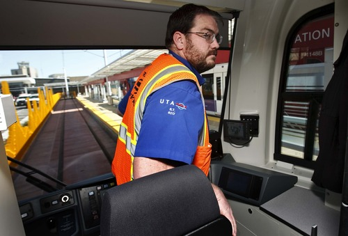 Leah Hogsten  |  Tribune file photo TRAX operator Seth Thompson steps off the new line to Salt Lake CIty International Airport on Wednesday, April 10, 2013. The six-mile line takes about 20 minutes to travel from downtown Salt Lake City to the airport as part of the green line from West Valley City. Trains will run every 15 minutes on weekdays, and every 20 minutes on weekends.