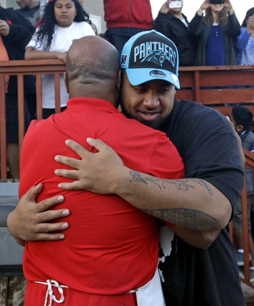 Star Lotulelei, from Utah, receives a hug from his uncle Ti Akau after being selected 14th overall by the Carolina Panthers during an NFL football draft party at their home, Thursday, April 25, 2013, in South Jordan, Utah. (AP Photo/Rick Bowmer)
