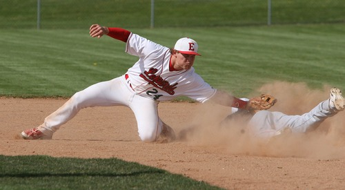Paul Fraughton  |   Salt Lake Tribune  East High shortstop Jeff Gilstrap stretches to make the tag out on  Woods Cross runner Shaden Fisher attempting to steal second. East defeated Woods Cross 12 to 10 at East High's field.                                                      Thursday, April 25, 2013