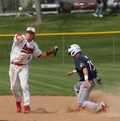 Paul Fraughton  |   Salt Lake Tribune  After making the force out on Woods Cross's Kyle Peay  Preston Curtis fires the ball to first to complete the double play.East defeated Woods Cross 12 to 10 at East High's field.                                                      Thursday, April 25, 2013