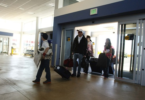 Leah Hogsten  |  Tribune file photo Passengers at Salt Lake City International Airport enter the TRAX welcome center on Wednesday, April 10, 2013. The six-mile line takes about 20 minutes to travel from downtown Salt Lake City to the airport as part of the green line from West Valley City. Trains will run every 15 minutes on weekdays, and every 20 minutes on weekends.