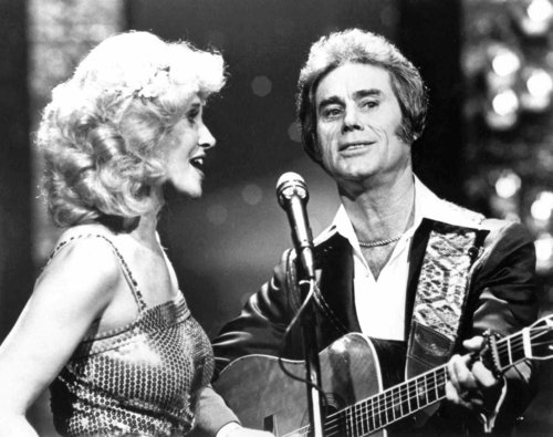 """FILE - In this undated photo, Tammy Wynette, left, sings with George Jones in Nashville.   Jones, the peerless, hard-living country singer who recorded dozens of hits about good times and regrets and peaked with the heartbreaking classic """"He Stopped Loving Her Today,"""" has died. He was 81. Jones died Friday, April 26, 2013 at Vanderbilt University Medical Center in Nashville after being hospitalized with fever and irregular blood pressure, according to his publicist Kirt Webster. (AP Photo/The Tennessean)"""