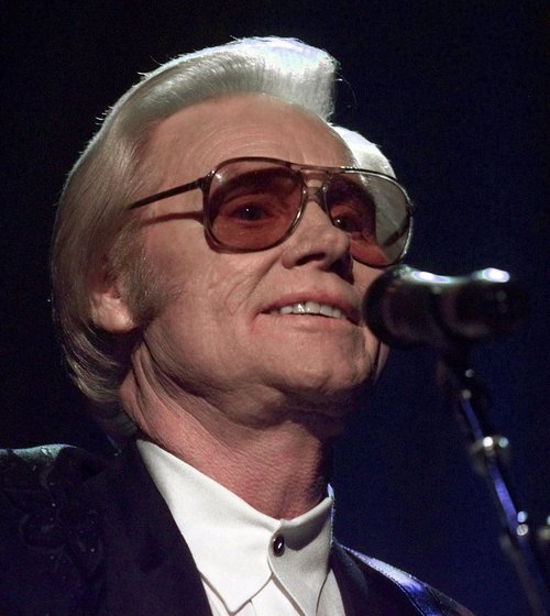"""FILE - In this June 1, 1999 file photo, Country music legend George Jones is shown during a performance in Nashville.  Jones, the peerless, hard-living country singer who recorded dozens of hits about good times and regrets and peaked with the heartbreaking classic """"He Stopped Loving Her Today,"""" has died. He was 81. Jones died Friday, April 26, 2013 at Vanderbilt University Medical Center in Nashville after being hospitalized with fever and irregular blood pressure, according to his publicist Kirt Webster. (AP Photo/John Russell, file)"""