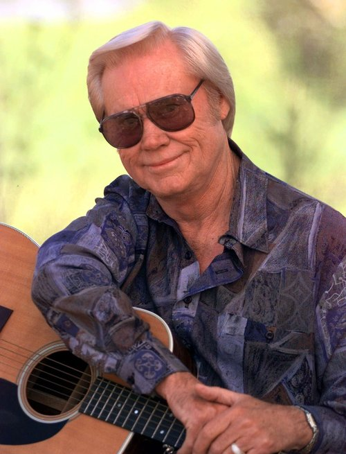 """FILE - In this April 1996 file photo, George Jones is shown in Nashville.   Jones, the peerless, hard-living country singer who recorded dozens of hits about good times and regrets and peaked with the heartbreaking classic """"He Stopped Loving Her Today,"""" has died. He was 81. Jones died Friday, April 26, 2013 at Vanderbilt University Medical Center in Nashville after being hospitalized with fever and irregular blood pressure, according to his publicist Kirt Webster. (AP Photo/Mark Humphrey, file)"""