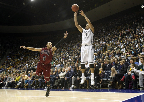 Brigham Young guard Raul Delgado (1) shoots past Loyola Marymount guard Anthony Ireland (3) during the first half of an NCAA college basketball game on Thursday, Jan. 3, 2013, in Provo, Utah. (AP Photo/The Salt Lake Tribune, Chris Detrick)  LOCAL TV OUT; MAGAZINES OUT; DESERET NEWS OUT