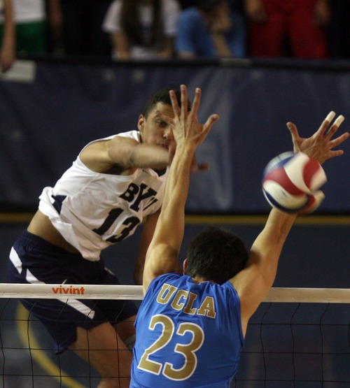 Kim Raff  |  The Salt Lake Tribune (left) BYU player Ben Patch spikes the ball through the hands of UCLA player (right) Gonzalo Quiroga during the semifinals of the MPSF Volleyball Tournament at the Smith Fieldhouse in Prove on April 25, 2013.  BYU went on to win the match 3-2 after trailing UCLA by two sets.