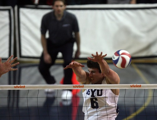 Kim Raff  |  The Salt Lake Tribune (middle) BYU player Josue Rivera tries to block a spike by UCLA during the semifinals of the MPSF Volleyball Tournament at the Smith Fieldhouse in Prove on April 25, 2013.  BYU went on to win the match 3-2 after trailing UCLA by two sets.