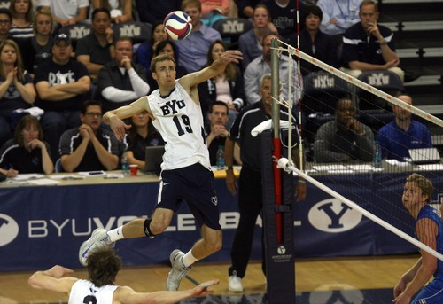 Kim Raff  |  The Salt Lake Tribune BYU player Devin Young spikes the ball against UCLA during the semifinals of the MPSF Volleyball Tournament at the Smith Fieldhouse in Prove on April 25, 2013.  BYU came back to win the match 3-2 after trailing UCLA by two sets.