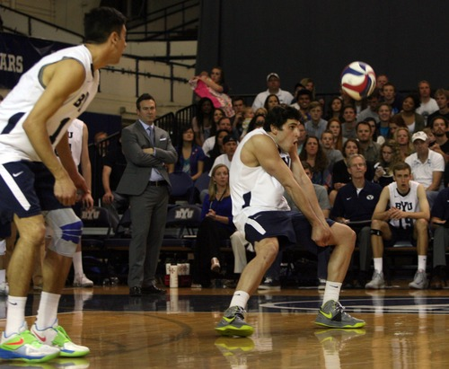 Kim Raff  |  The Salt Lake Tribune (middle) BYU player Josue Rivera bumps the ball after a UCLA serve during the semifinals of the MPSF Volleyball Tournament at the Smith Fieldhouse in Prove on April 25, 2013.  BYU went on to win the match 3-2 after trailing UCLA by two sets.
