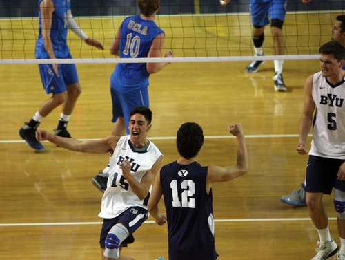 Kim Raff  |  The Salt Lake Tribune BYU players Taylor Sander and (right) Jaylen Reyes celebrate scoring a point against UCLA during the semifinals of the MPSF Volleyball Tournament at the Smith Fieldhouse in Prove on April 25, 2013.  BYU went on to win the match 3-2 after trailing UCLA by two sets.