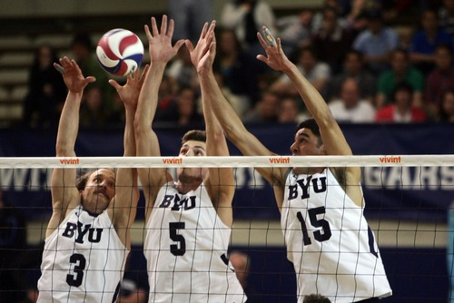 Kim Raff  |  The Salt Lake Tribune BYU players (from left) Ryan Boyce, Russ Lavaja, and Taylor Sander block a spike by a UCLA player during the semifinals of the MPSF Volleyball Tournament at the Smith Fieldhouse in Prove on April 25, 2013.  BYU went on to win the match 3-2 after trailing UCLA by two sets.