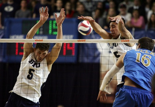 Kim Raff  |  The Salt Lake Tribune BYU players (left) Russ Lavaja and (right) Taylor Sander block a spike by UCLA player Dane Worley during the semifinals of the MPSF Volleyball Tournament at the Smith Fieldhouse in Prove on April 25, 2013.  BYU went on to win the match 3-2 after trailing UCLA by two sets.