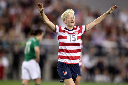 ADVANCE FOR USE SUNDAY, APRIL 28, 2013 AND THEREAFTER - United States' Megan Rapinoe celebrates her goal against Ireland in an international friendly soccer match in Glendale, Ariz. on Saturday, Dec. 1, 2012. High-profile lesbian athletes have come out while still playing their sports, but not a single gay male athlete in major U.S. professional sports has done the same. (AP Photo/Paul Connors)