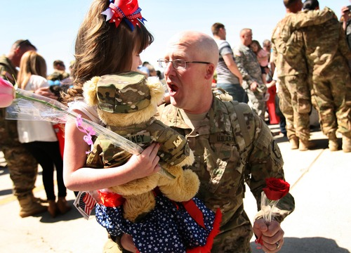 Leah Hogsten  |  The Salt Lake Tribune Sgt. Sterling Wilkey is greeted by his daughter Madison, 6. Twenty-seven babies, including two sets of twins, were born to wives and partners of returning soldiers of the Utah National Guard's 624th Engineer Company, 1457th Engineer Battalion,Thursday, April 25, 2013, during their 10-month deployment to Afghanistan.