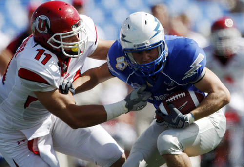 Utah defensive end Paul Kruger, left, tackles Air Force wide receiver Kyle Halderman in the first quarter of an NCAA college football game on Saturday, Sept. 20, 2008, at Air Force Academy, Colo. (AP Photo/David Zalubowski)