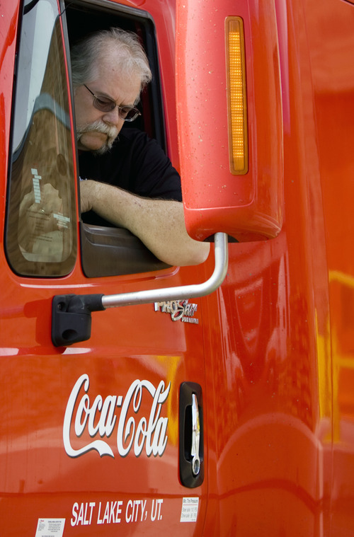 Kim Raff  |  The Salt Lake Tribune Craig Vorwaller, a Ryder truck driver for Swire CocaCola, pulls onto a truck scale before heading out on a transport in West Valley City on April 25, 2013. Vorwaller has been recognized by Ryder for driving 3.1 million miles over his 34-year professional driving career.