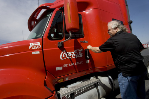 Kim Raff  |  The Salt Lake Tribune Craig Vorwaller, a Ryder truck driver for Swire CocaCola, gets in the cab of his truck to hook up a trailer before heading out on a transport in West Valley City on April 25, 2013. Vorwaller has been recognized by Ryder for driving 3.1 million miles over his 34-year professional driving career.