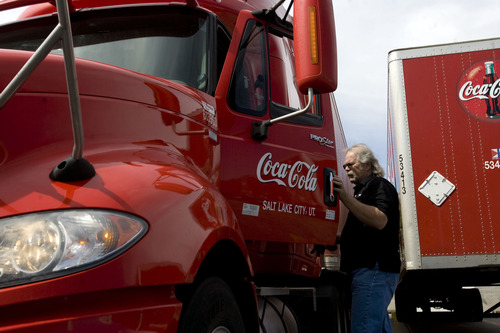 Kim Raff  |  The Salt Lake Tribune Craig Vorwaller, a Ryder truck driver for Swire CocaCola, climbs into the cab of a tractor trailer before heading out on a transport in West Valley City on April 25, 2013. Vorwaller has been recognized by Ryder for driving 3.1 million miles over his 34-year professional driving career.