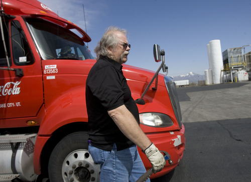 Kim Raff  |  The Salt Lake Tribune Craig Vorwaller, a Ryder truck driver for Swire CocaCola, hooks up a trailer to his truck before heading out on a transport in West Valley City on April 25, 2013. Vorwaller has been recognized by Ryder for driving 3.1 million miles over his 34-year professional driving career.
