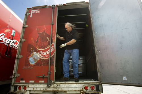 Kim Raff  |  The Salt Lake Tribune Craig Vorwaller, a Ryder truck driver for Swire CocaCola, secures the cargo in the bed of his trailer before heading out on a transport in West Valley City on April 25, 2013. Vorwaller has been recognized by Ryder for driving 3.1 million miles over his 34-year professional driving career.