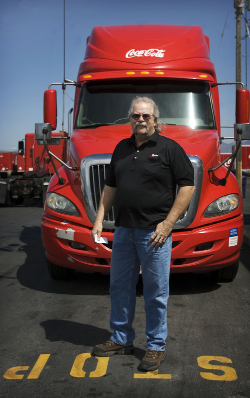 Kim Raff  |  The Salt Lake Tribune Craig Vorwaller, a Ryder truck driver for Swire CocaCola, poses for a portrait in front of his truck in West Valley City on April 25, 2013. Vorwaller has been recognized by Ryder for driving 3.1 million miles over his 34-year professional driving career.