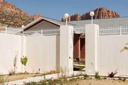 Trent Nelson  |  The Salt Lake Tribune A high wall and secure door conceal a home built for polygamous leader Warren Jeffs and hidden behind multiple high walls in Hildale on Friday. The property was purchased by former FLDS spokesman Willie Jessop, who spent the day allowing former followers to see the inside of a compound they had previously not been allowed to enter. Jeffs, locked up in a Texas prison, never lived in the home.