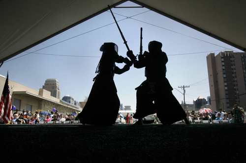 "Scott Sommerdorf  |  The Salt Lake Tribune Kendo fighters from ""Zenbukan"" demonstrate their art at the 8th annual Nihon Matsuri Japanese festival, Saturday, April 27, 2013."