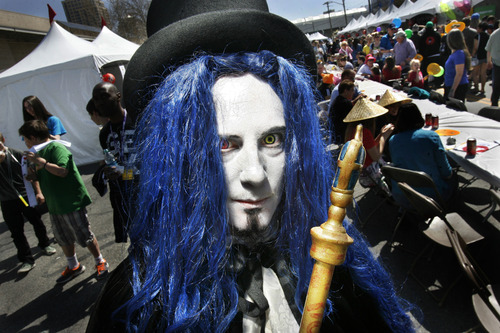 "Scott Sommerdorf   |  The Salt Lake Tribune Sterling Cornia dresses as ""Gankutsuou,"" the Count of Monte Cristo, as he walks through the 8th annual Nihon Matsuri Japanese festival, Saturday, April 27, 2013."